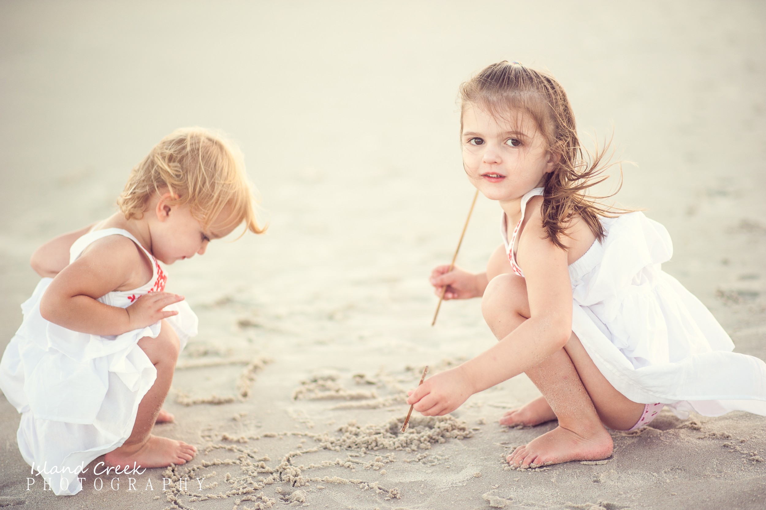 Children Playing In The Sand During Beach Photography Session On North Topsail Carolina